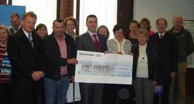 Patient support group present cheque for new freezer
